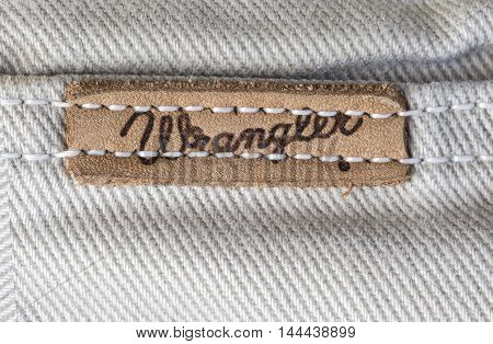 Chisinau Moldova - August 19 2016: Closeup of Wrangler label on white jeans. Wrangler is American manufacturer of jeans. Its headquarters is in Greensboro North Carolina USA.