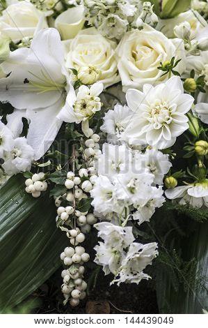 Festive Arrangement of several sorts of White flowers