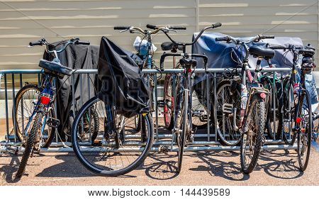 covered and uncovered bicycles and bikes rack