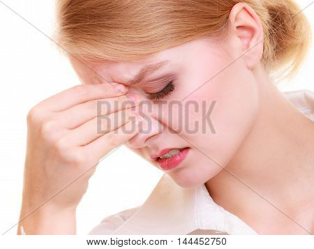 Headache migraine and sinus ache. Stressed businesswoman worried young woman suffering from head or nose pain isolated on white.