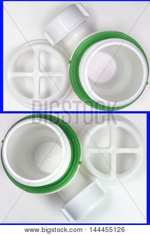 Pair of plastic strainer for drain for hole of the sink. A fragment of the drain system