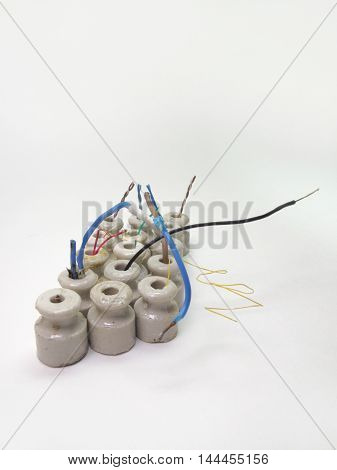a bunch of ceramic insulators small size bonded colored wires