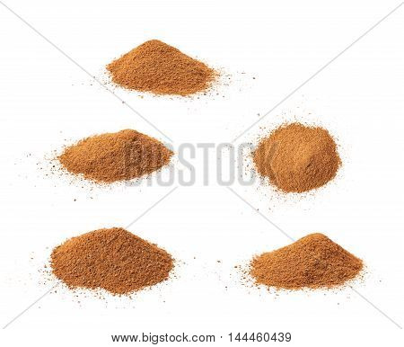 Pile of cinnamon powder isolated over the white background, set of five different foreshortenings
