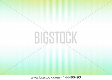 Green blue and white blurred rays of light blend to create abstract background