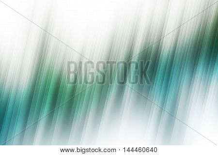 Green and blue blurred rays of light blend to create abstract background