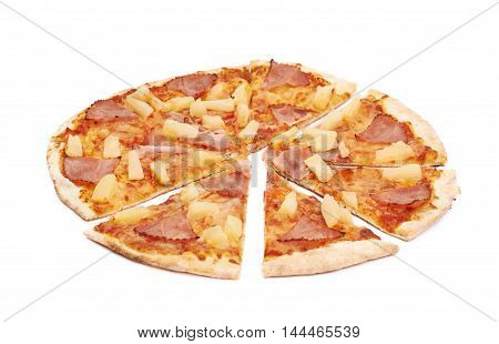 Whole hawaiian pizza sliced, composition isolated the white background