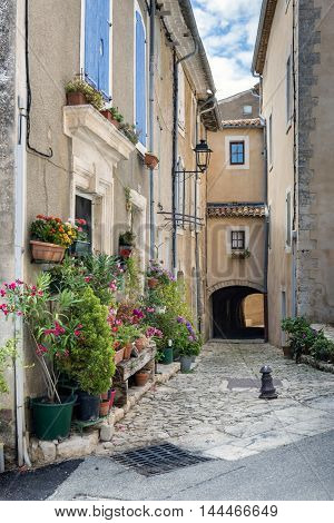 Narrow street in in Saint-Saturnin-les-Apt village in France
