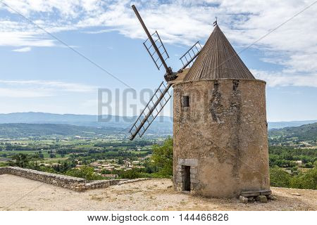 Old stone windmill in Saint Saturnin les Apt Provence France