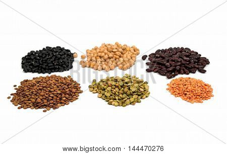 collection of legumes (chickpeas green peas red lentils canadian lentils yellow lentils yellow peas red beans) isolated on white background