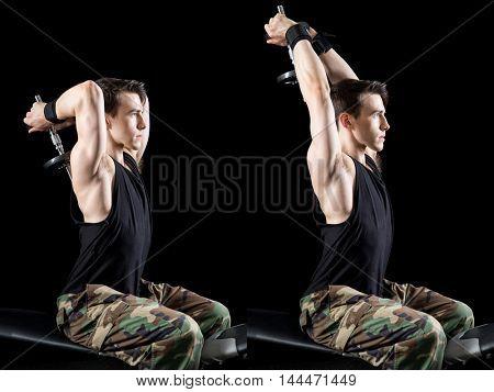 Overhead triceps press exercise. Studio shot over black.