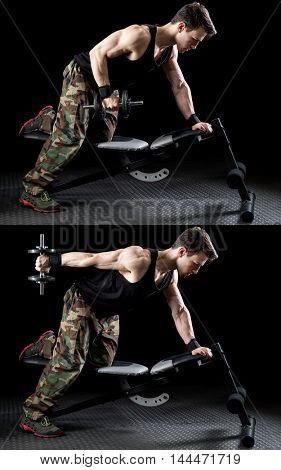 Triceps kickback exercise. Studio shot over black.