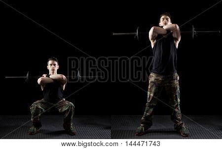 Front squat exercise. Studio shot over black.