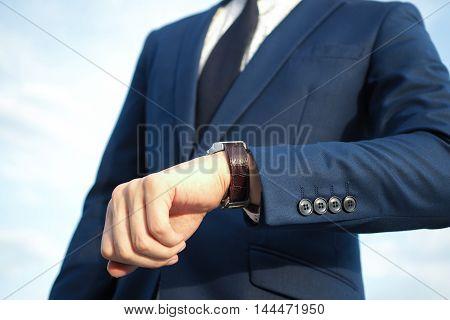 Businessman In Elegant Blue Suit Looking At Luxury Watch Waiting