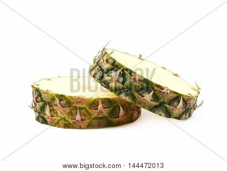 Two pineapple cross-section slices isolated over the white background