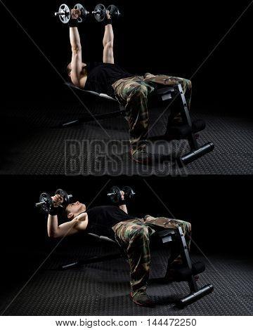 Dumbbell chest press exercise. Studio shot over black.