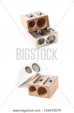 Two, metal and wooden pencil sharpeners, composition isolated over the white background, set of two different foreshortenings
