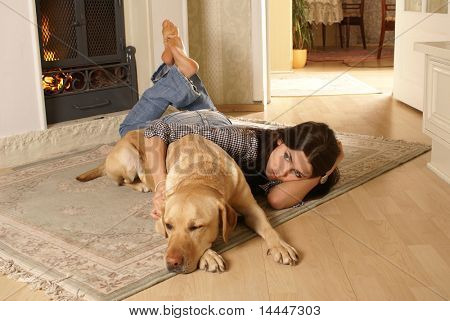 Attractive woman with the dog on the flor poster