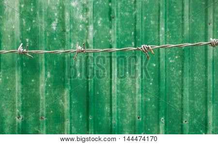 barbed wire and old Metal sheet fence Background