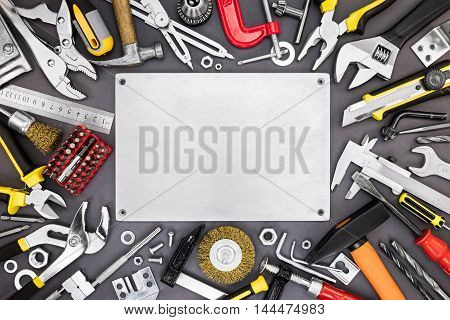 Set Of Renovation And Working Tools On Diy Table Background