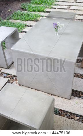 Concrete outdoor furniture set in the small garden stock photo