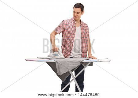 Guy ironing a t-shirt on an ironing board isolated on white background