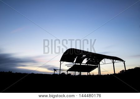 Derelict Barn Silhouette Against Beautiful Vibrant Sunset Landscape