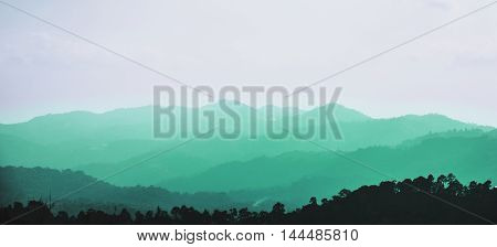 Panorama, Mountain ridges with silhouette forest in the foreground. Background ridge with spruce forest in the foreground, and layer of hills
