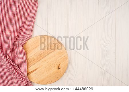 empty wooden cutting board and cloth red napkin
