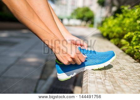Woman fixing the shoes lace