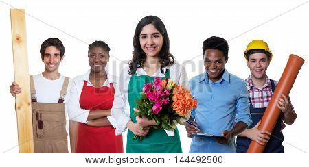 Laughing arabic florist with group of other international apprentices on an isolated white background for cut out