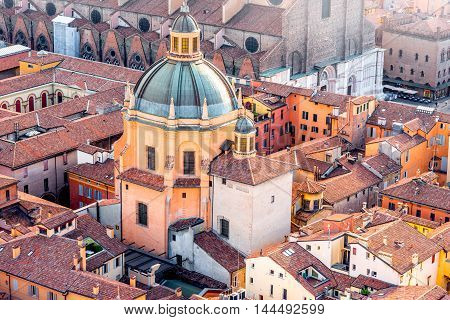 Aerial cityscape view from the tower on Bologna old town with Santa Maria della Vita church in Italy