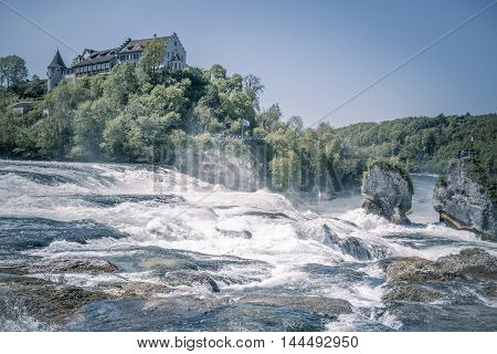 Rhine river and its waterfall - Image with the Laufen Castle on a hill and the Rhine river at its feet. Picture captured in Switzerland the municipality of Laufen-Uhwiesen