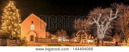 Winter night lights in an Austrian village - Night photography in the Ehrwald village from Austria during winter season when all the buildings and trees are decorated with lights.