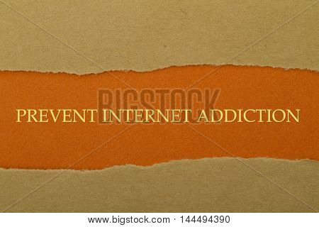 Prevent Internet Addiction written under torn paper.