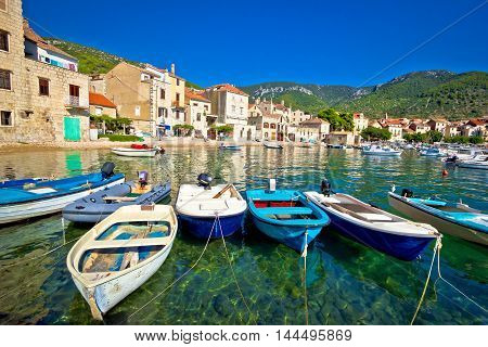 Komiza on Vis island turquoise waterfront boats and town view Dalmatia Croatia