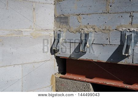 Galvanised joist hangers within interior of house build in progress.
