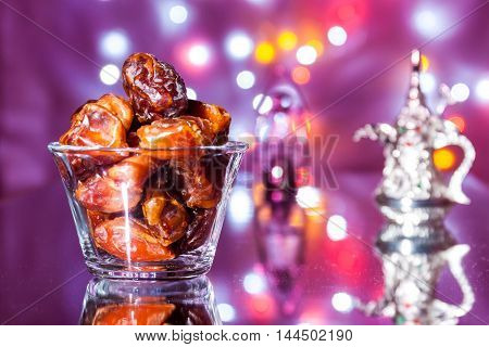 Date fruits in glass bowl. Eid Al Adha concept