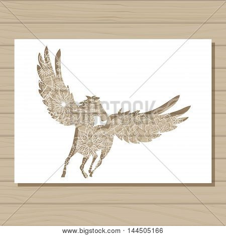Vector stencil template of pegasus on wooden background