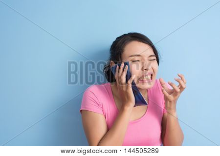 Asian young woman feel hurt with hypersensitive teeth,  closeup portrait with copyspace