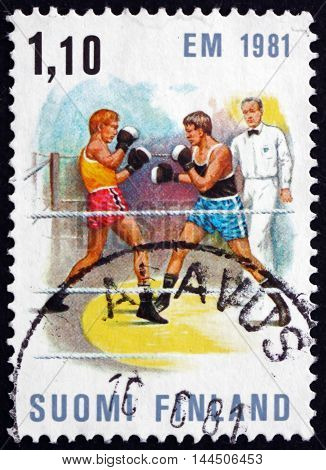 FINLAND - CIRCA 1980: a stamp printed in Finland shows Boxing Match European Boxing Championships Tampere circa 1980