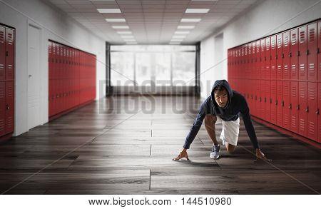 African American man about to run in school corridor with lockers. Concept of physical education. 3d rendering.