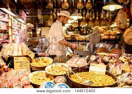 Bologna, Italy - May 24, 2016: Food store showcase full of food in Bologna city in Italy