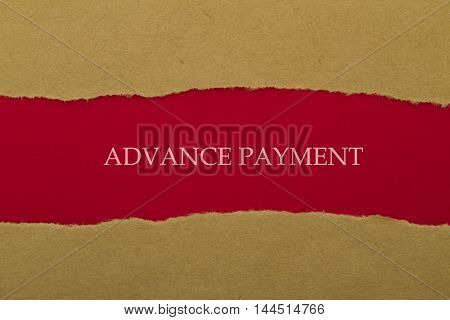 Advance payment written under torn paper .