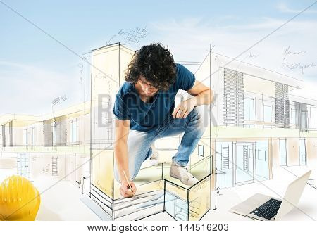 Man draws and designs the screening of a house