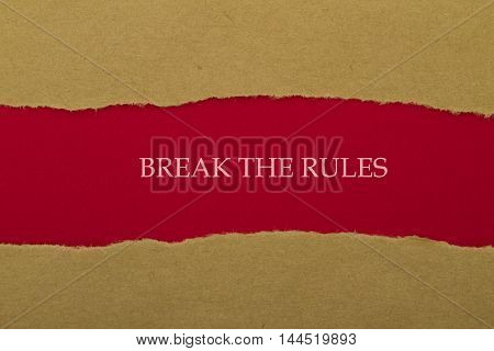 BREAK THE RULES word written under torn paper .