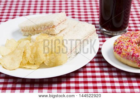 Unhealthy lunch An unhealthy child's snack lunch of sandwiches and donut
