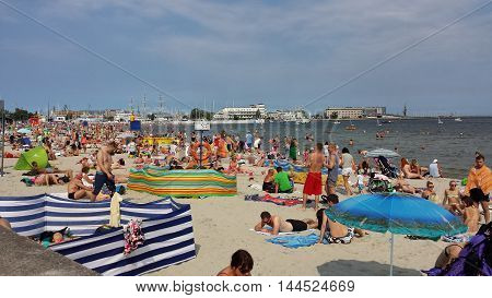 Gdynia, Poland - August 27, 2016: People sunbathing and lounging on the beach in Gdynia, Poland