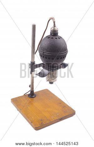 Historical photographic enlarger darkroom equipment on white background