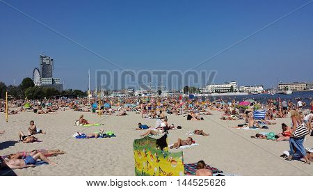Gdynia, Poland - August 28, 2016: People sunbathing and lounging on the beach in Gdynia, Poland