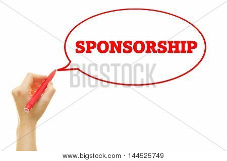 Hand writing Sponsorship word on a transparent wipe board.